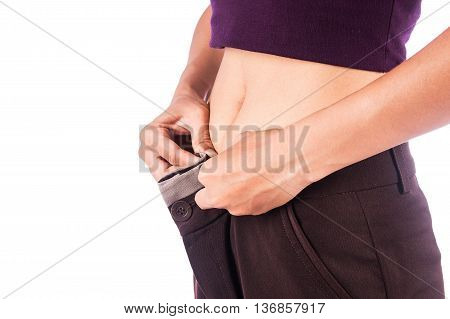 Slim waist of beauty woman in big trousers after weight loss