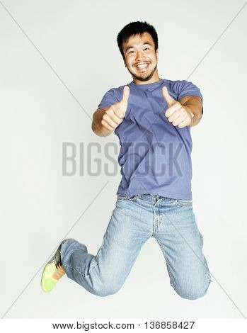 young pretty asian man jumping cheerful against white background, lifestyle people concept isolated