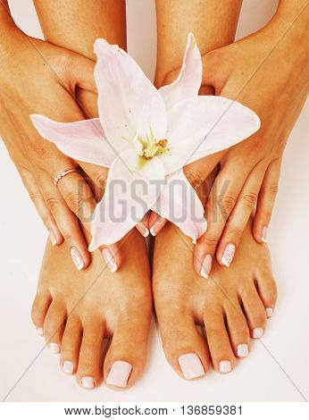 French manicure pedicure with flower lily close up isolated on white perfect shape hands feet