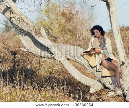 beauty young woman in savanna walking, dreaming, making notes, trip alone