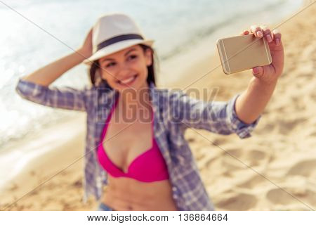Girl With Gadget On The Beach