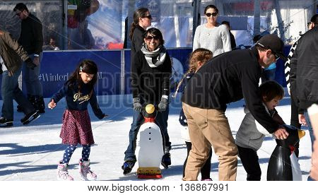 Sydney Australia - July 3 2016. Kids learning to skate on the ice rink at Hyde Park. The Winter Festival's in Sydney are Australia's largest winter events featuring open-air ice-skating.