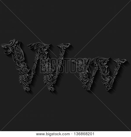 Handsomely decorated letter w in upper and lower case on black