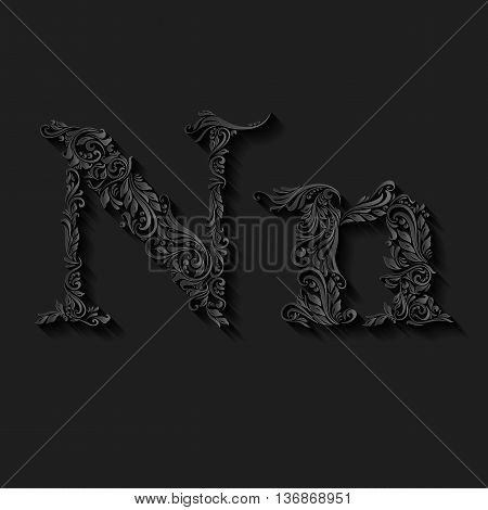 Handsomely decorated letter n in upper and lower case on black
