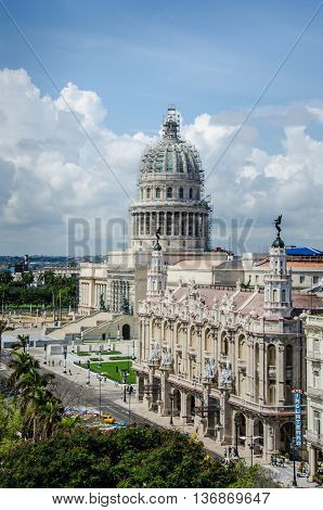 HAVANA - CUBA JUNE 16, 2016: The National Capitol Building (El Capitolio Nacional), undergoing major renovations, is home to the Cuban Academy of Sciences while Havana's Great Theatre (Gran Teatro de La Habana) provides the stage for the Cuban National Ba