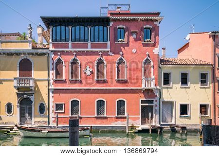 Picturesque buildings on the sides of a canal in Chioggia lagoon of Venice.