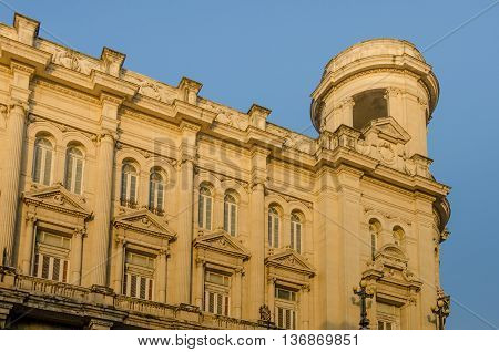 Havana, Cuba - June 11, 2016: The tower at sunset of the National Museum of Fine Arts (Museo Nacional de Bellas Artes), built in 1927 in the Spanish renaissance style. This museum houses art from European Masters as well as a collection ancient art, from