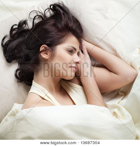 Pretty Young Woman In Bed