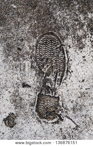 Foot print on grunge concrete texture, vertical