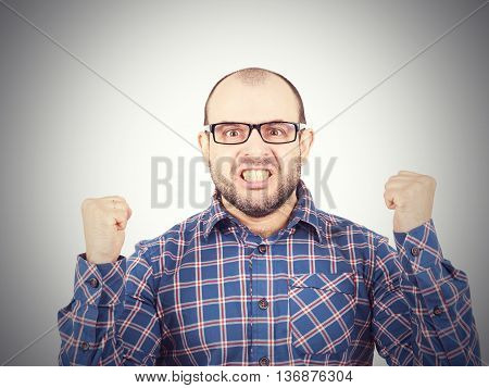 Angry Bald Man In Glasses.