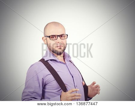 Bald Man With Beard In Shirt With Suspenders.