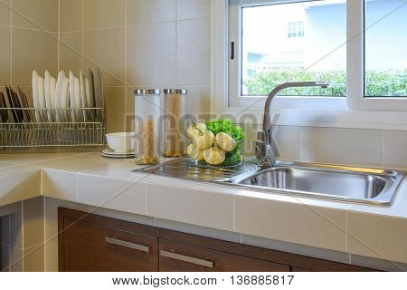 modern pantry with utensil on white counter in kitchen