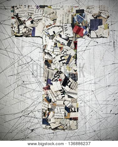The letter  T  made from newspaper confetti