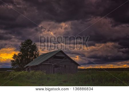 Abandoned Barn House Under The Storm Clouds