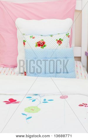Close-up of a little girl's bed at home