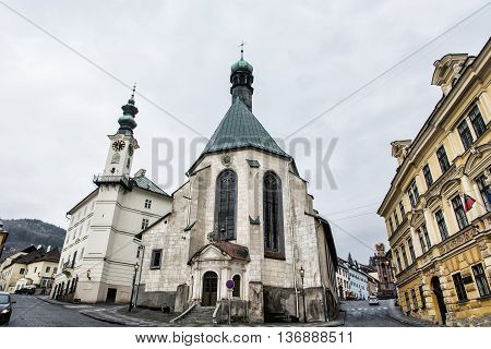 Saint Catherine's church and town hall in Banska Stiavnica city Slovak republic. Cultural heritage. Architectural scene. Travel destination. Place for worship. Streets and buildings.