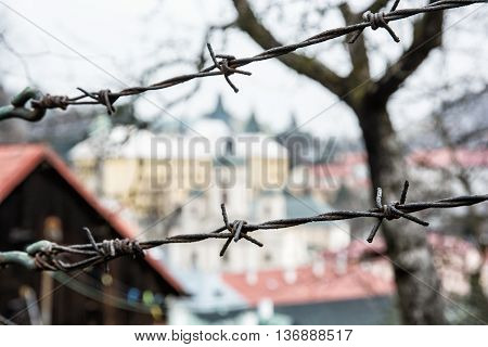 Barbed wire fence in old town Banska Stiavnica Slovak republic. Security theme. Travelling in Europe. Private property.