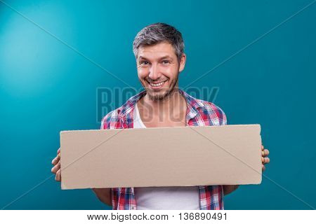 smiling laughing happy man holding cardboard