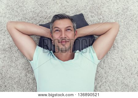 man thinking relaxing on the ground