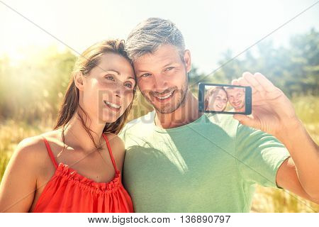 camera selfie with mobile on the beach