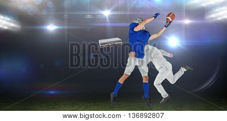 Businessman tackling a football player against american football arena