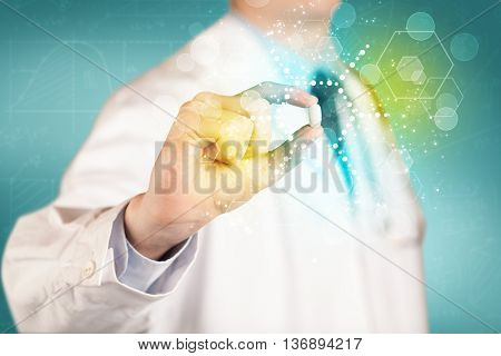 A male doctor in white coat with a stethoscope holding a pill with glowing colorful dots and lines