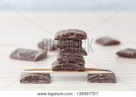 Dark Cooking Chocolate Chunks Arranged On Toothpicks
