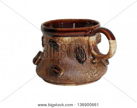 Pottery coffee cup with a relief of coffee beans on the side on a white background. Clipping.