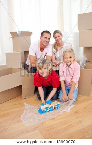 Animated children playing with a train while moving house