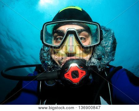 Underwater scuba diver making self portrait or selfie. Having fun underwater in Adriatic Sea - Croatia.