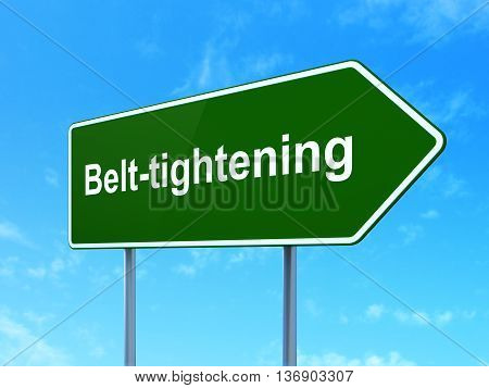 Business concept: Belt-tightening on green road highway sign, clear blue sky background, 3D rendering