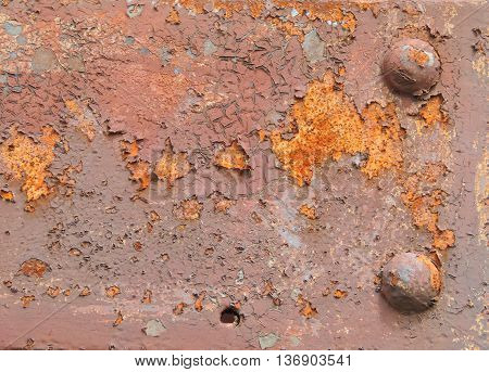 rusty background with rivets,  peeling off paint