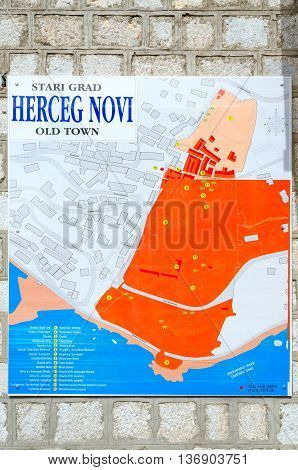HERCEG NOVI MONTENEGRO - SEPTEMBER 25 2015: Plan of Old Town on stone wall of building located on Nikola Dzhurkovicha Square in Herceg Novi Montenegro