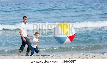 Jolly Father and his son having fun at the beach