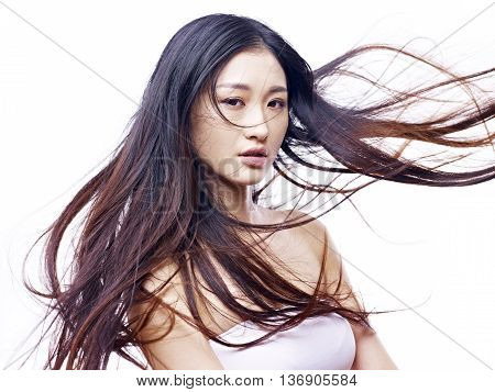 studio portrait of a young and beautiful asian fashion model isolated on white background.