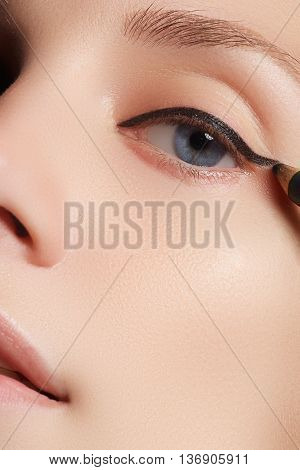 Make-up Beauty With Brush Eye Liner On Pretty Woman Face