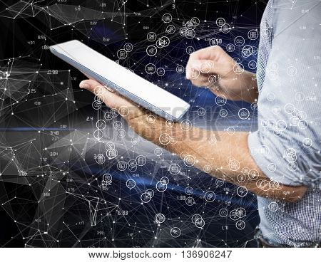 Businessman using digital tablet over white background against black background with shiny lines
