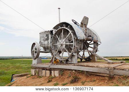VOLGOGRAD RUSSIA - June 19 2016: The retro monument a tractor - to the first plowmen of the earth tatsinsky is devoted. Rostov region. Highway M21 Rostov region Russia