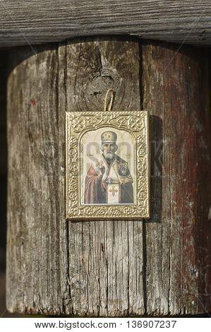 Saint Nicholas icon on grey wood close up