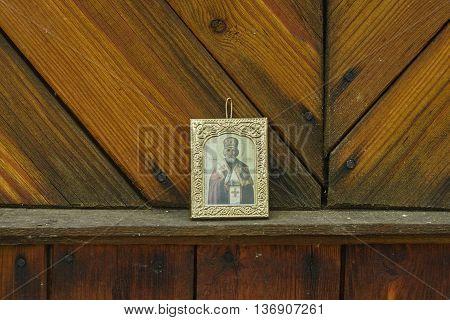 Saint Nicholas icon on old board wall