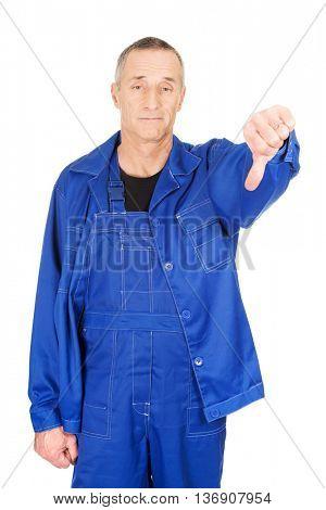 Repairman showing thumbs down