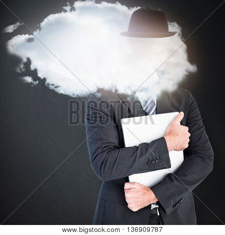 Businessman holding his laptop tightly against grey background