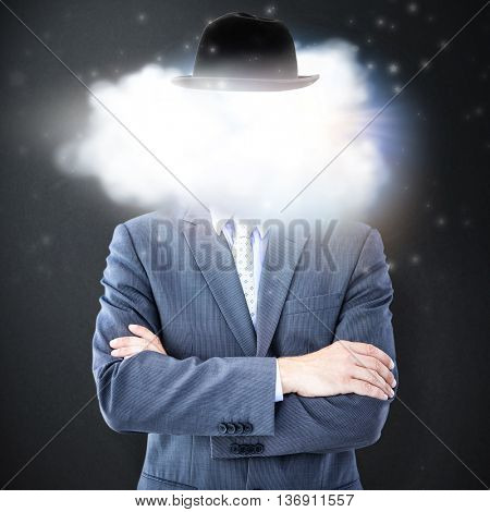 Midsection of businessman standing arms crossed against grey background