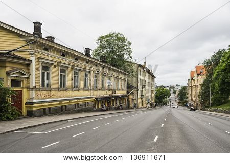 TURKU, FINLAND - JUNE 24: Wooden house and Art Nouveau buildings in Turku, Finland at June 24,2016