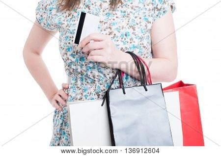 Close-up Of Woman With Bags And Debit Card
