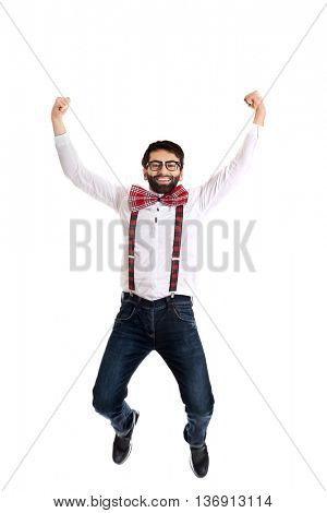 Old fashioned man wearing suspenders jumping.