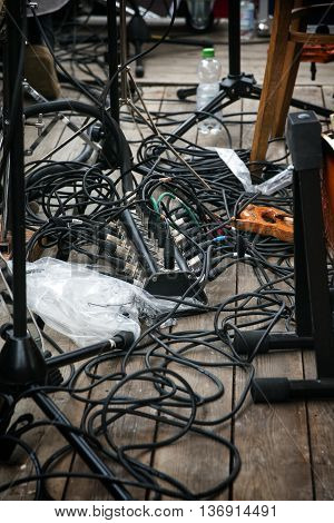 cabling on stage for the amplifier system of a rock or pop band selected focus narrow depth of field
