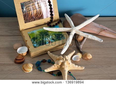 Composition of sea shells, stars and album reminiscent of the summer holidays.