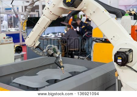 Robotic arm. Industrial robot arm for welding.