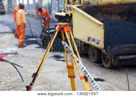 Survey equipment at asphalting works. Road construction and repairing works.
